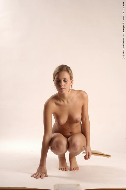 Naked Woman Sitting Down