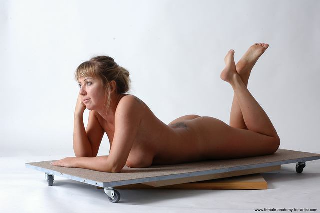 nude woman laying on her stomach