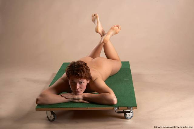 Nude Woman White Laying poses - ALL Slim Laying poses - on stomach short red