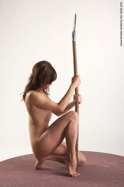 Nude Fighting with spear Woman White Kneeling poses - ALL Slim Kneeling poses - on one knee long brown