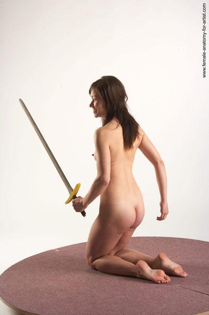 Nude Fighting with sword Woman White Kneeling poses - ALL Slim Kneeling poses - on both knees long brown