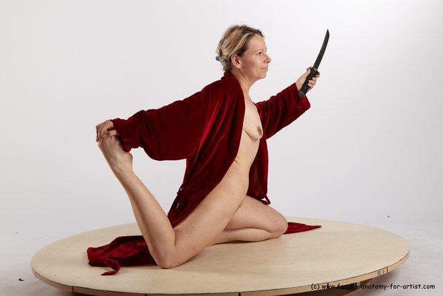 Drape Fighting with sword Woman White Kneeling poses - ALL Average Kneeling poses - on both knees medium blond