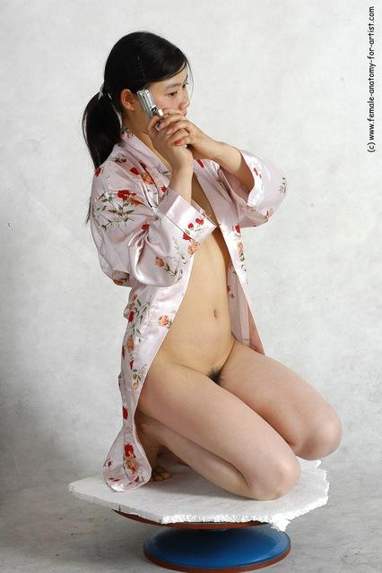Drape Fighting with gun Woman White Sitting poses - ALL Slim long black Sitting poses - on knees