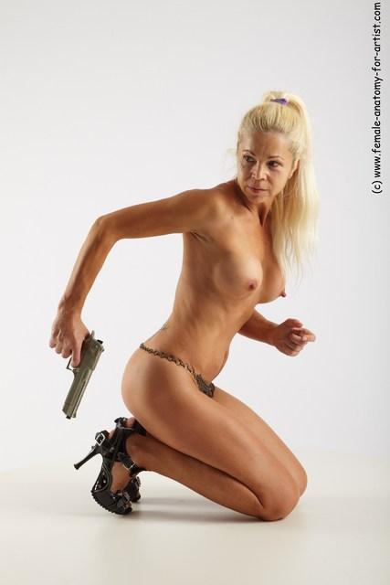 Nude Fighting with gun Woman White Kneeling poses - ALL Slim Kneeling poses - on both knees long blond