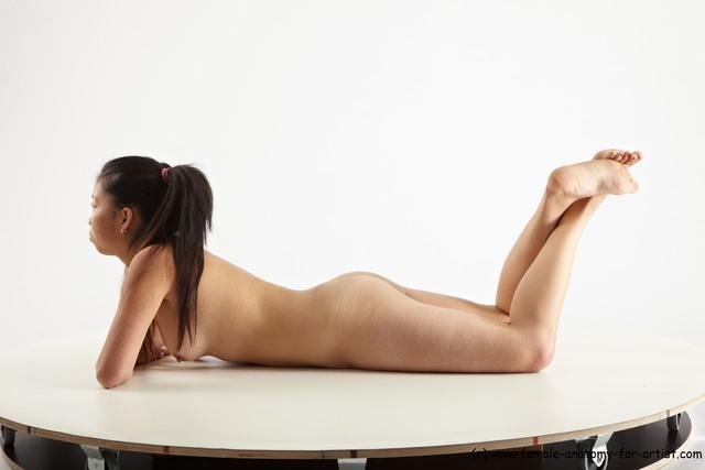 nude-women-on-their-stomachs-barcalona-football-club-strip