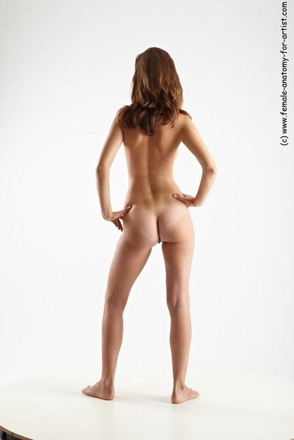 Beautiful nude ladies standing