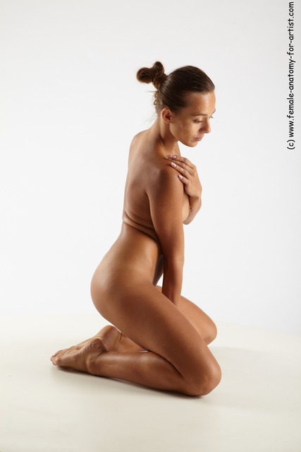 Amusing Females posing nude on knees