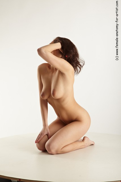 Females posing nude on knees