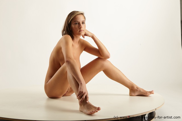 Nude female art model poses all