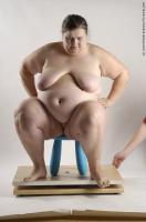 Photo Reference of natasa sitting pose 100