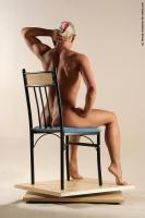 Photo Reference of kristin sitting pose 28