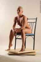 Photo Reference of kristin sitting pose 24