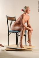 Photo Reference of kristin sitting pose 22