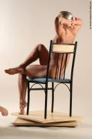 Photo Reference of kristin sitting pose 10