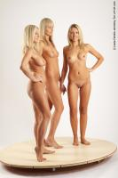 Photo Reference of 3women standing pose 24