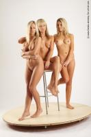 Photo Reference of 3women standing pose 16