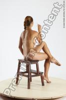 Photo Reference of ingrida sitting pose 07b