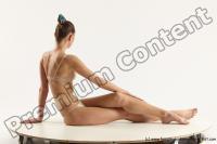Photo Reference of evelina sitting pose 09b