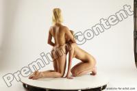 Photo Reference of iris peggy pose kneeling