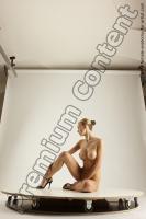 Photo Reference of eula sitting pose 01